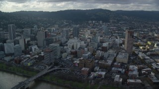 AX154_237 - 6K stock footage aerial video orbiting skyscrapers near US Bancorp Tower in Downtown Portland, Oregon