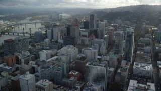 AX154_244 - 6K stock footage aerial video flying over downtown to approach KOIN Center and Wells Fargo Center in Downtown Portland, Oregon