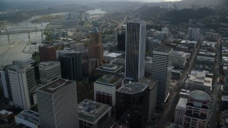 AX154_245 - 6K stock footage aerial video flying over KOIN Center, Wells Fargo Center, and 200 Market in Downtown Portland, Oregon