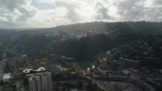 AX154_246 - 6K stock footage aerial video approaching the Oregon Health and Science University complex in the hills over Portland, Oregon