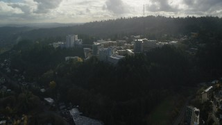 AX154_247 - 6K stock footage aerial video flying by the Oregon Health and Science University complex in the hills over Portland, Oregon