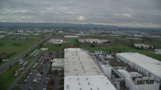 AX155_001 - 6K stock footage aerial video flying over SolarWorld plant and approach Jireh Semiconductor, Hillsboro, Oregon