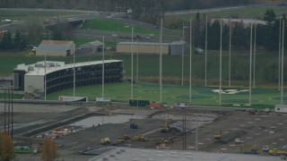 AX155_003 - 6K stock footage aerial video of Topgolf course flyby, Hillsboro, Oregon