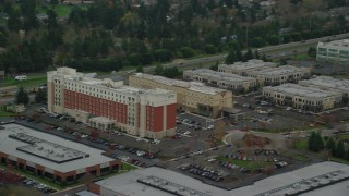 AX155_005 - 6K stock footage aerial video tracking Embassy Suites buildings in Hillsboro, Oregon