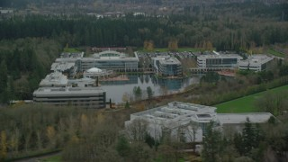 AX155_011 - 6K stock footage aerial video passing by Nike Headquarters office buildings in Beaverton, Oregon