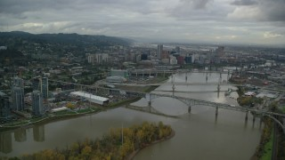 AX155_024 - 6K stock footage aerial video flying by Ross Island Bridge near Downtown Portland, Oregon, and South Waterfront condo high-rises