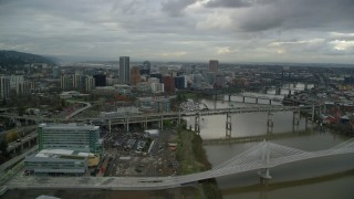 AX155_028 - 6K stock footage aerial video flying over Marquam Bridge to approach Riverplace Marina and Downtown Portland, Oregon