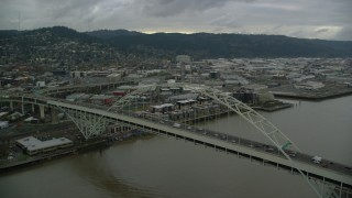 AX155_034 - 6K stock footage aerial video orbiting the Fremont Bridge in Downtown Portland, Oregon