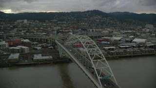 AX155_035 - 6K stock footage aerial video orbiting the Fremont Bridge and reveal skyscrapers in Downtown Portland, Oregon