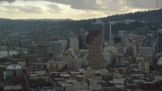 AX155_040 - 6K stock footage aerial video flying by US Bancorp Tower and skyscrapers in Downtown Portland, Oregon