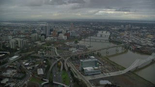 AX155_049 - 6K stock footage aerial video approaching Marquam Bridge and Riverplace Marina near skyscrapers in Downtown Portland, Oregon