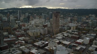 AX155_053 - 6K stock footage aerial video flying away from skyscrapers, downtown buildings, and US Bancorp Tower, reveal Willamette River in Downtown Portland, Oregon