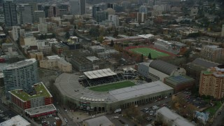 AX155_057 - 6K stock footage aerial video tilting to and flyby Providence Park in Goose Hollow, Portland, Oregon