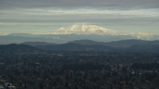 AX155_062 - 6K stock footage aerial video of snowy Mount Hood seen from suburban residential neighborhoods in Portland, Oregon