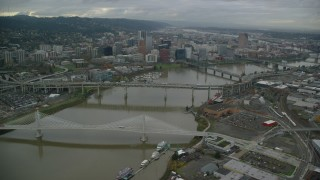 AX155_063 - 6K stock footage aerial video flying over bridges to approach Downtown Portland, Oregon