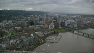 AX155_064 - 6K stock footage aerial video flying over marina, KOIN Center, Wells Fargo Center and reveal PacWest Center in Downtown Portland, Oregon