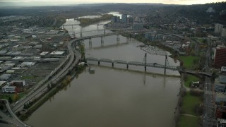 AX155_069 - 6K stock footage aerial video orbiting Marquam Bridge, Riverplace Marina, Hawthorne Bridge and reveal Downtown Portland, Oregon