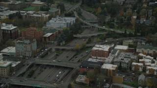 AX155_072 - 6K stock footage aerial video of I-405 freeway and overpasses beside Portland State University in Downtown Portland, Oregon