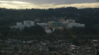 AX155_079 - 6K stock footage aerial video of Oregon Health and Science University in the hills over Portland, Oregon