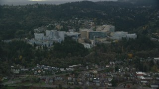 AX155_080 - 6K stock footage aerial video approaching the Oregon Health and Science University in the hills over Portland, Oregon