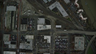 AX155_087 - 6K stock footage aerial video of a bird's eye view of city streets and riverfront condos, reveal Broadway Bridge and the Willamette River in Downtown Portland, Oregon