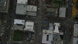 AX155_090 - 6K stock footage aerial video of a bird's eye view of SW 12th Avenue and downtown buildings in Downtown Portland, Oregon