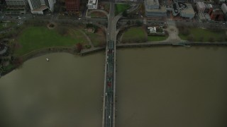 AX155_096 - 6K stock footage aerial video of a bird's eye view of the Hawthorne Bridge becoming SW Madison Street and the waterfront park in Downtown Portland, Oregon