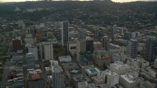 AX155_104 - 6K stock footage aerial video slowly orbiting around skyscrapers in Downtown Portland, Oregon