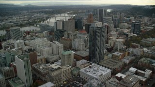 AX155_112 - 6K stock footage aerial video orbiting skyscrapers and high-rises in Downtown Portland, Oregon, and reveal US Bancorp Tower