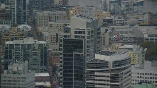 AX155_117 - 6K stock footage aerial video tracking the tops of Park Avenue West Tower and Fox Tower in Downtown Portland, Oregon