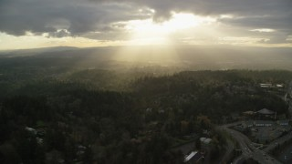 AX155_118 - 6K stock footage aerial video of godrays shining on neighborhoods and Highway 26, Southwest Portland, Oregon