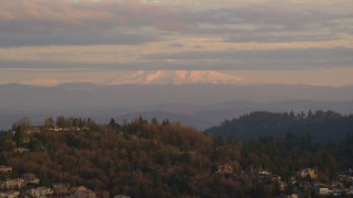 AX155_136 - 6K stock footage aerial video of Mount Hood seen from hillside homes in Northwest Portland, Oregon