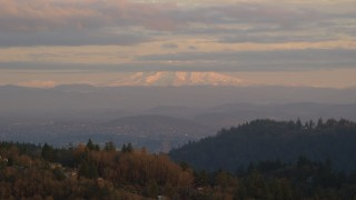 AX155_137 - 6K stock footage aerial video of Mount Hood seen from hills in Northwest Portland, Oregon