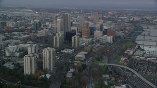 AX155_151 - 6K stock footage aerial video orbiting Downtown Portland and riverfront condos at twilight in Oregon