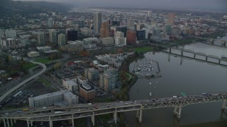 AX155_152 - 6K stock footage aerial video of riverfront condos, marina and Downtown Portland at twilight, seen from across the Willamette River