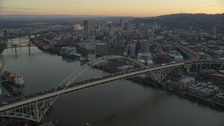 AX155_162 - 6K stock footage aerial video flying over heavy traffic on the Fremont Bridge at twilight, approach Downtown Portland, Oregon