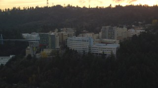 AX155_168 - 6K stock footage aerial video flying by Oregon Health and Science University in Portland, Oregon, twilight