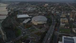 AX155_176 - 6K stock footage aerial video of I-5, Veterans Memorial Colosseum, Moda Center, and convention center in Lloyd District, Portland, Oregon, twilight