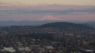 AX155_177 - 6K stock footage aerial video of Northeast Portland neighborhoods with Mount Hood in the distance at twilight, Oregon