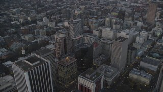 AX155_216 - 6K stock footage aerial video flying over 1000 Broadway, Fox Tower, and Park Avenue West Tower at twilight, Downtown Portland, Oregon