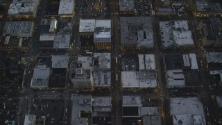 AX155_238 - 6K stock footage aerial video of a bird's eye view follow NW 5th Avenue at twilight, reveal US Bancorp Tower, Downtown Portland, Oregon