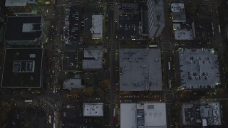 AX155_244 - 6K stock footage aerial video of a bird's eye view following SW 5th Avenue at twilight through Downtown Portland, Oregon