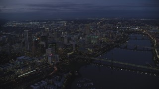 AX155_268 - 6K stock footage aerial video of Downtown Portland's cityscape beside the Willamette River at twilight, Oregon