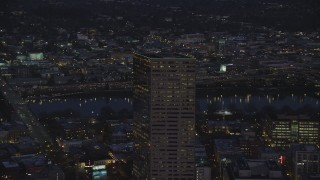 AX155_274 - 6K stock footage aerial video orbiting the top of US Bancorp Tower at night in Downtown Portland, Oregon
