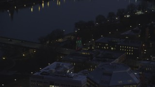 AX155_276 - 6K stock footage aerial video of the White Stag sign and NW Naito Parkway at night in Downtown Portland, Oregon