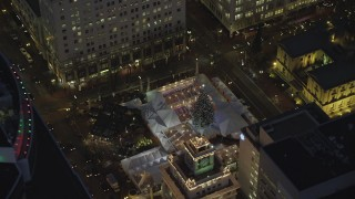 AX155_284 - 6K stock footage aerial video of a bird's eye orbit Pioneer Courthouse Square, decorated for Christmas, at night in Downtown Portland, Oregon