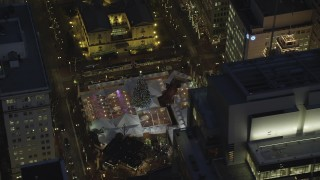 AX155_285 - 6K stock footage aerial video of a bird's eye orbiting Pioneer Courthouse Square, decorated for Christmas, at night in Downtown Portland, Oregon