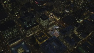 AX155_287 - 6K stock footage aerial video of a bird's eye orbit Pioneer Courthouse Square, decorated for Christmas, and Pioneer Courthouse at night in Downtown Portland, Oregon