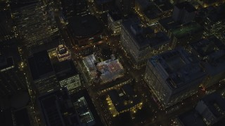 AX155_288 - 6K stock footage aerial video of a bird's eye of Pioneer Courthouse Square, decorated for Christmas, Pioneer Courthouse, and reveal Hilton Portland at night in Downtown Portland, Oregon