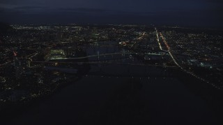AX155_291 - 6K stock footage aerial video of Downtown Portland cityscape and bridges on the Willamette River at night, Oregon